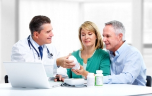pharmacist and elderly couple talking
